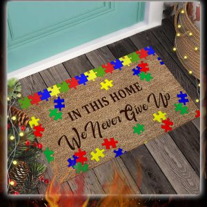 Autism awareness in this home we never give up doormat 1