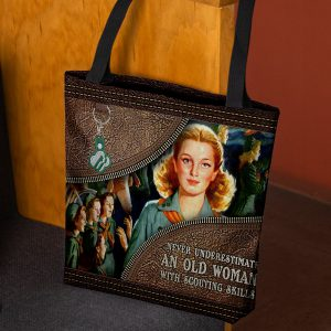 Never underestimate an old woman with scouting skills tote bag